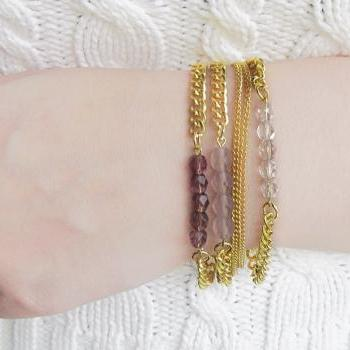 Bead Bracelet Stack in Transparent Shades of Purple on Gold Chain